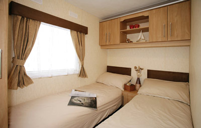 The twin bedroom in the Denbigh Deluxe