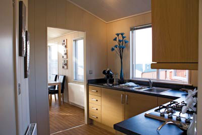 The L-shaped kitchen in the Lindera