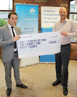 Ross Gardiner of Leisuredays presents the NCC a cheque