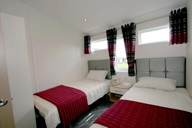 Large twin beds in bedroom