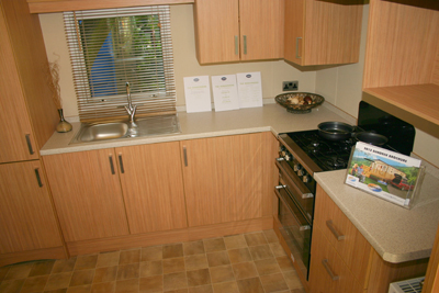 There is adequate worktop space and storage in the kitchen