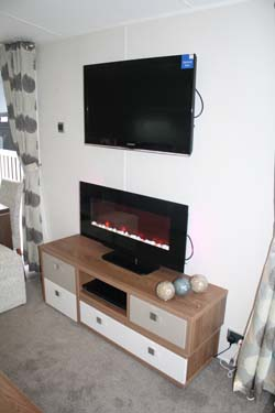 TV unit inside the Willerby 2014 3-bed Skyline holiday home