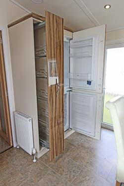 Victory Versailles holiday lodge fridge freezer & pull out storage racks