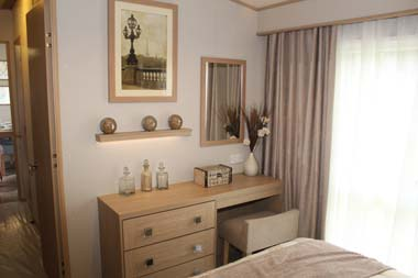 ABI Roxbury holiday home - The dressing table and stool in the master bedroom.