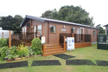 The Willerby Clearwater Series 2 holiday lodge with the optional Canexel cladding and bay window.