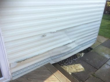 Storm damage to side panel