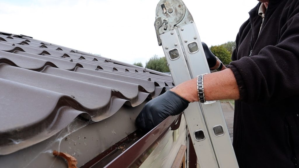 Static caravan cleaning gutters