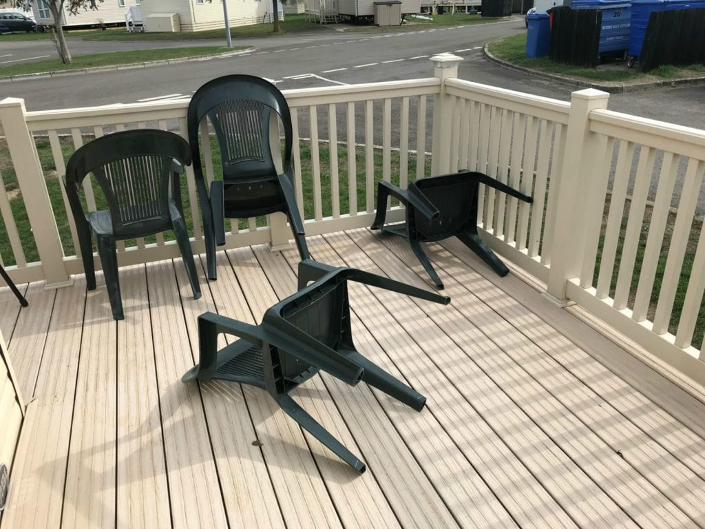 overturned furniture on decking